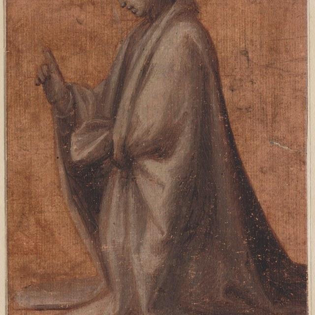 Vrouw, geknield naar links, in zware mantel