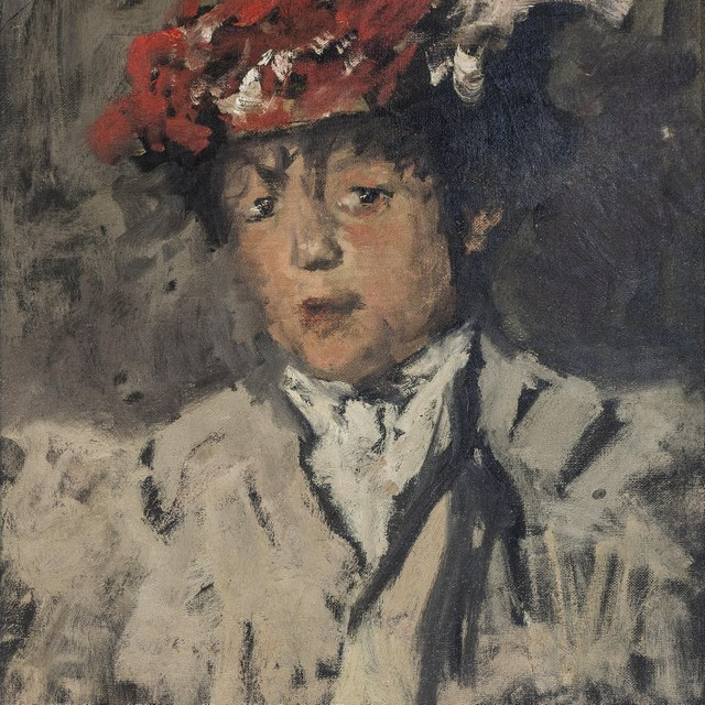 Portret van jonge vrouw met rode hoed