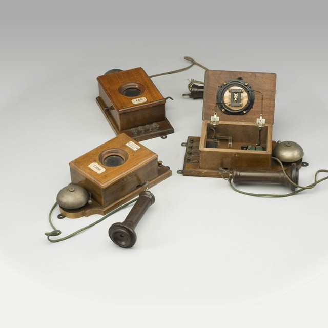 Three almost identical telephone sets, after Bell