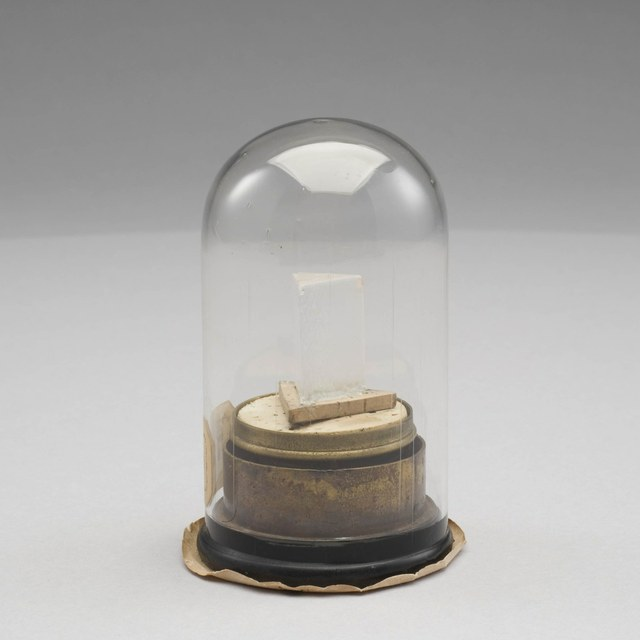 Prism: rock crystal, on base and with dome