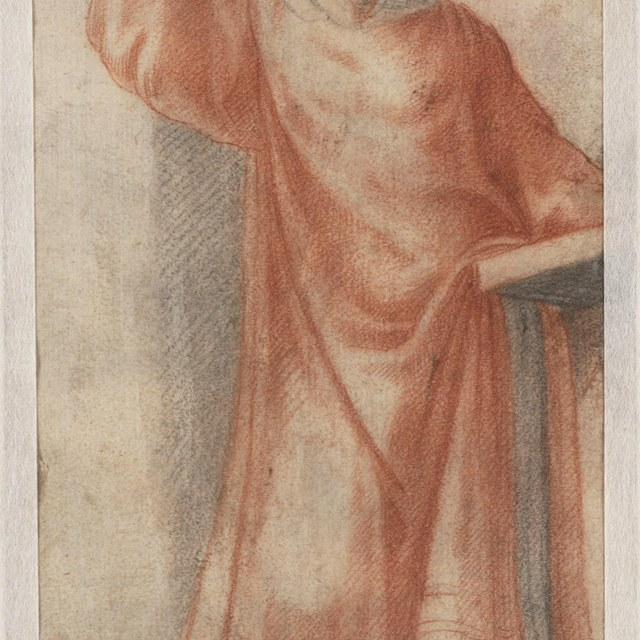 Staande geestelijke met een boek