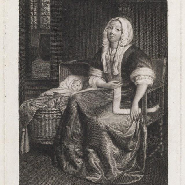 Interieur met vrouw en kind in wieg