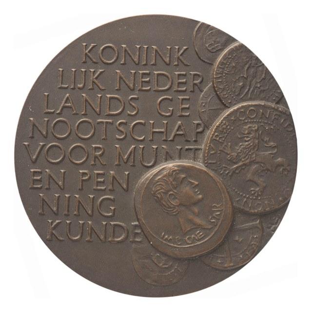 Erepenning van het Koninklijk Nederlands Genootschap voor Munt- en Penningkunde, op naam van Hans de Koning.